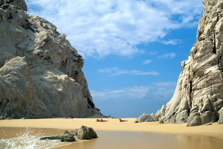 Tourists sunbathing at Lovers Beach Lands End exico Cabo San Lucas