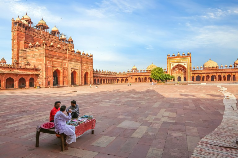 Fatehpur Sikri Agra medieval architecture with view of giant red sandstone gateway known as Buland Darwaza built by Mughal Emperor Akbar - TWN569