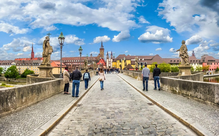 Famous Alte Mainbrucke the historic city of Wurzburg on a sunny day, region of Franconia, Northern Bavaria, Germany
