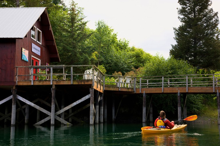 Kayaking in front of the Experience Art Gallery Halibut Cove Kachemak Bay near Homer Alaska model released