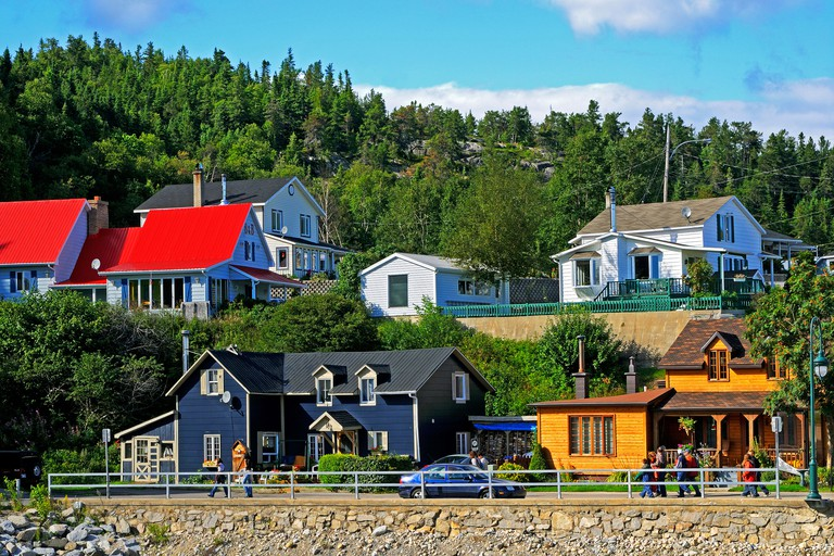 Village scene in Tadoussac on the shore of the St Lawrence River near its confluence with the Saguenay River, Tadoussac, Canada