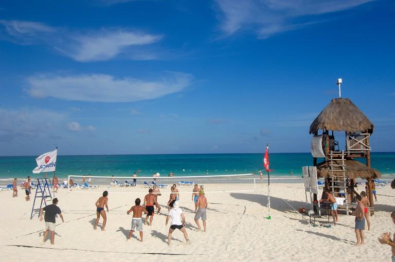 People playing beach volleyball at Maroma beach Caribe Quintana Roo state Mayan Riviera Yucatan Peninsula Mexico