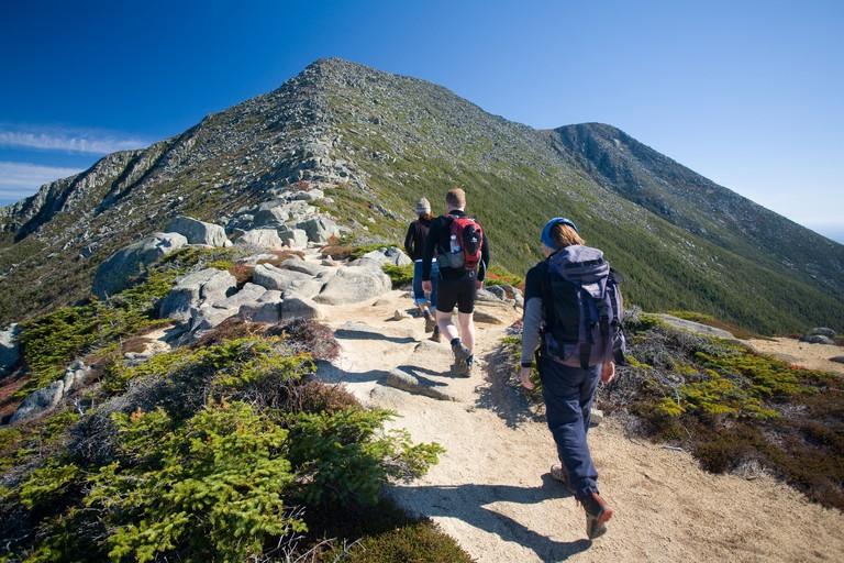 Hikers on the Appalachian Trail climbing Mt Katahdin, Baxter State Park, Maine, USA.