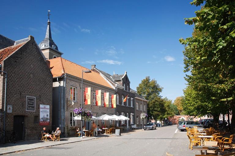 Tourists on pavement cafe at Oud-Rekem, Maasland, Belgium