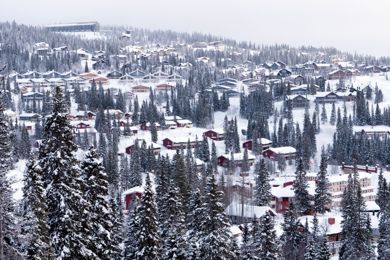 View of holiday chalets above Are ski resort in Sweden in winter