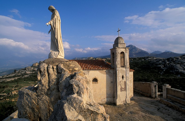 Corsica Madonna Statue Chapelle Notre Dame de la Serra near Calvi France Europe figure rock chapel religion