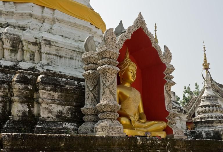 A Buddha at Wat Buppharam in Chiang Mai in Thailand