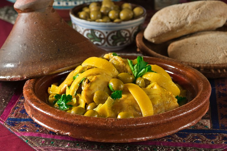 Tagine of chicken with green olives and lemon. Morocco Food.