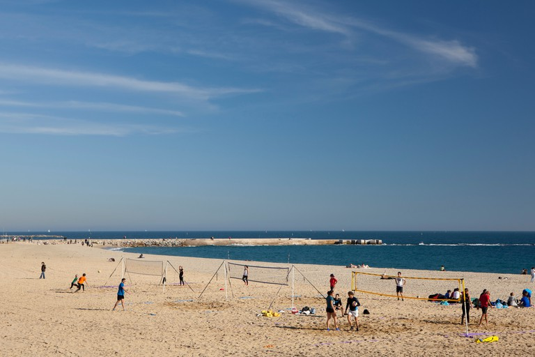 Playing volleyball in Bogatell beach, Barcelona, Spain