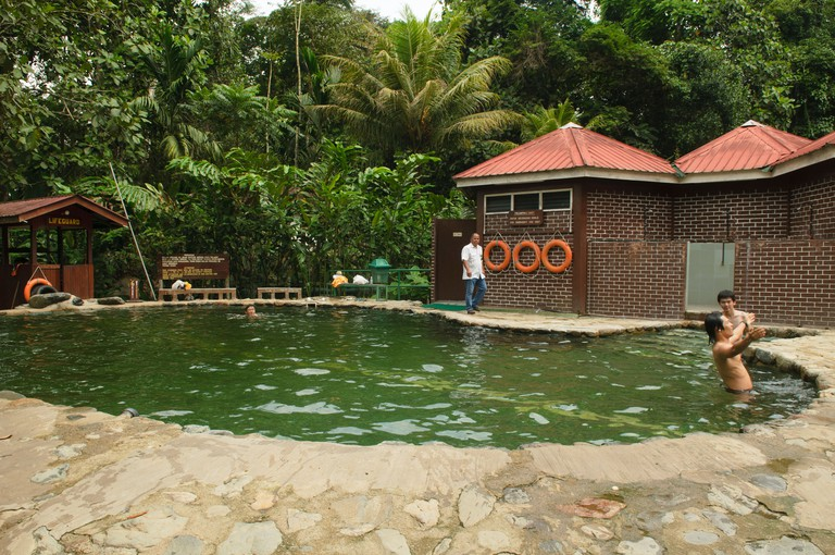bathers enjoy the Poring Hot Springs in Sabah, Borneo, Malaysia