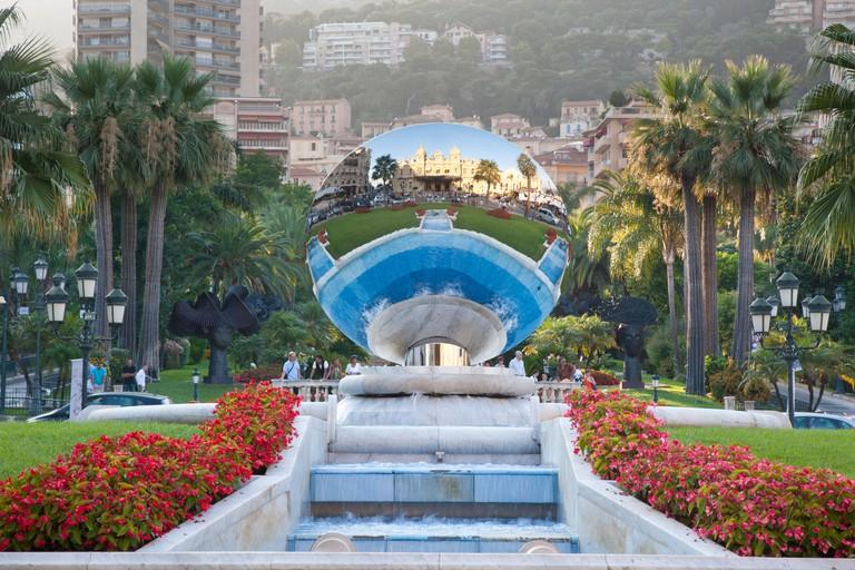 silver reflective disc sculpture with the casino reflected in Monte Carlo, Monaco