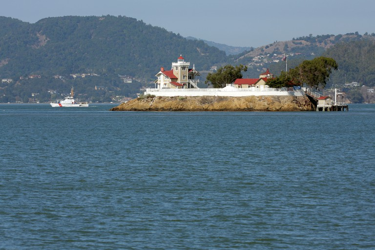 Coast Guard Cutter passes by East Brother Light Station off of Point Richmond in San Francisco Bay.