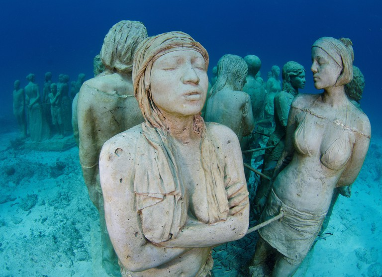 Mexico Cancun Sculptures at bottom sea in Cancun Underwater Museum in Caribbean Sea