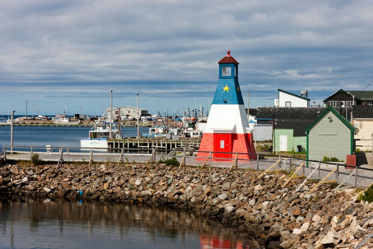 Acadian lighthouse on boardwalk along the Cheticamp waterfront, Cape Breton, Nova Scotia, Canada.