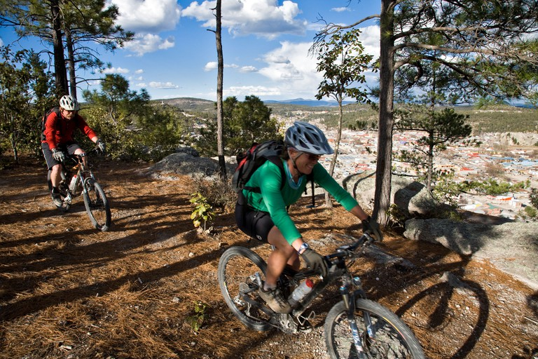 Rachel Schmidt and Scott Davis mountain biking above the town of Creel in the Copper Canyon area Mexico. Image shot 2008. Exact date unknown.