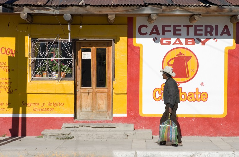 Man walking in a street of Creel a popular tourist destination in the Tarahumara Sierra Mexico and gateway to Copper Canyon