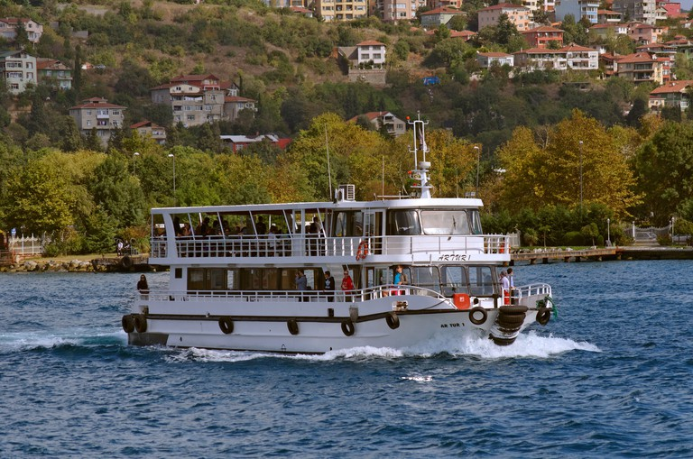 Tourism or Ferry boat on the Bosphorus Strait betyween Europe and Asia at Istanbul, Turkey.