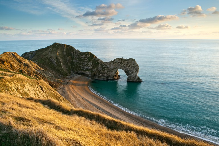 Durdle Door, a natural rock arch, on the Jurassic Coast in Dorset UK photographed in late afternoon in January