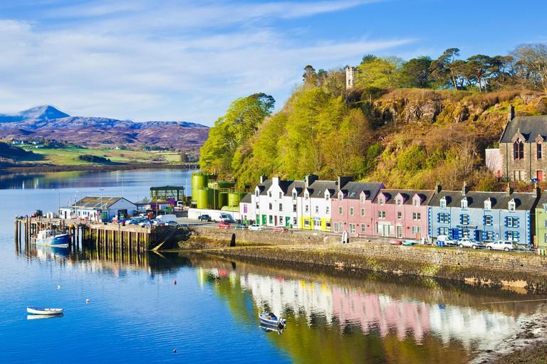 Multi-coloured houses in Portree harbour Isle of Skye Highlands and Islands Scotland UK GB EU Europe