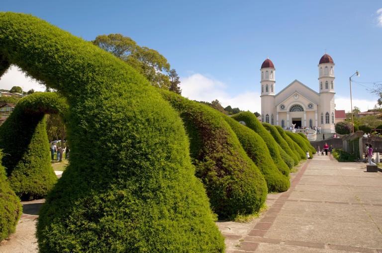 The San Rafael church with arched shrubs in Zacero, Costa Rica, Central America