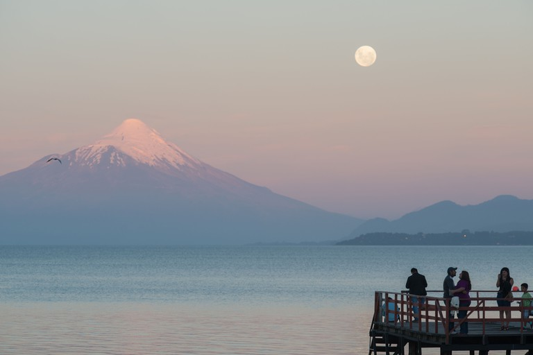 Full Moon over Lake Llanquihue and Osorno Vocano seen from Puerto Varas Chile