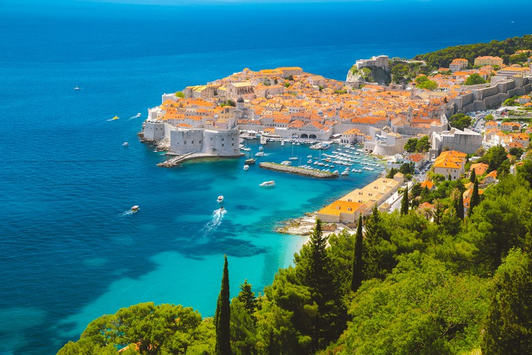 Panoramic aerial view of the historic town of Dubrovnik, one of the most famous tourist destinations in the Mediterranean Sea, from Srd mountain P5GKR9