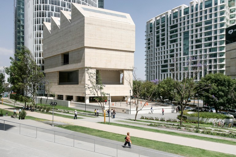 elegant exterior of travertine clad Museo Jumex in context of mixed use Plaza Carso with high rise apartments & office building