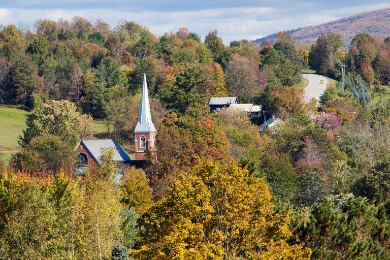 Canada, Quebec province, Eastern Townships or Estrie, Frelighsburg, the church, the road and the colors of the Indian summer