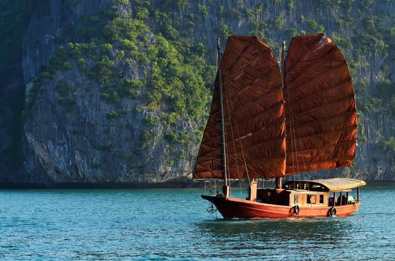 Vietnam, Quang Ninh province, Ha Long bay, listed as World Heritage by UNESCO, junk boat in the bay