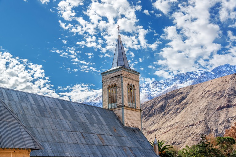 Church with Andes mountains in the background in Pisco Elqui in the Elqui Valley in Chile