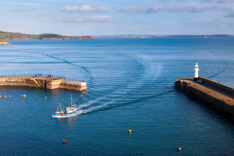 Overlooking the entrance to Mevagissey Harbour Cornwall England UK Europe