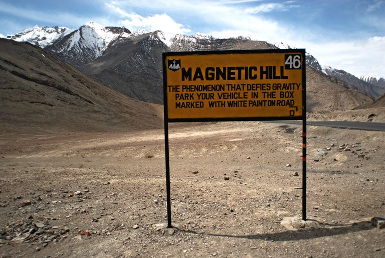 Signboard of Magnetic Hill ; Magnet Hill , Cyclops hill , Leh ; Ladakh ; Jammu and Kashmir ; India , Asia