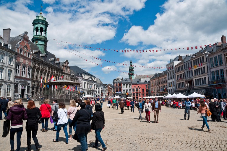 Festival goers in the Main Square of Mons, Belgium, for the annual Doudou festival