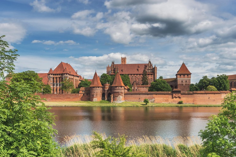 Castle of the Teutonic Order in Malbork, Poland on the river Nogat. The castle complex is the largest brick building in Europe