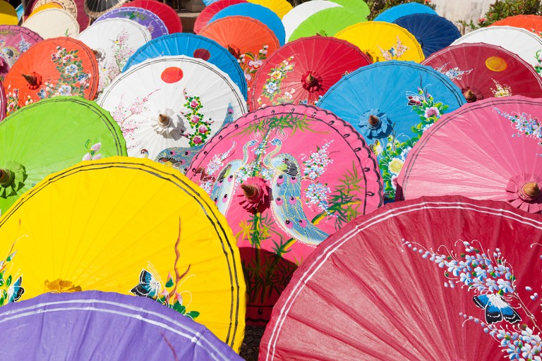 Handmade paper umbrellas drying in the sun at an umbrella factory in Bo Sang, Chiang Mai province, Thailand