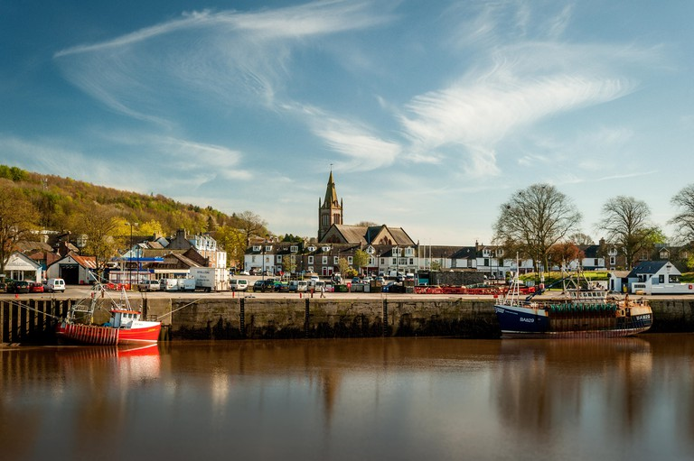 A view of Kirkcudbright, Scotland from the Kirkcudbright bridge over the river Dee.