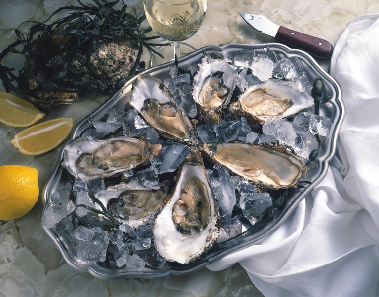 Tray of fresh oysters in shells, Whitstable, Kent, England, United Kingdom