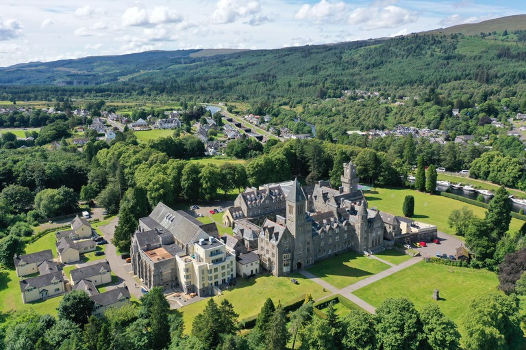 W5XNH6 Fort Augustus, UK, 30 July 2019. Fort Augustus Abbey on the shore of Loch Ness. The Scottish Child Abuse Inquiry has been hearing of abuse suffered by residents of the former boarding school. Credit: Andrew Smith