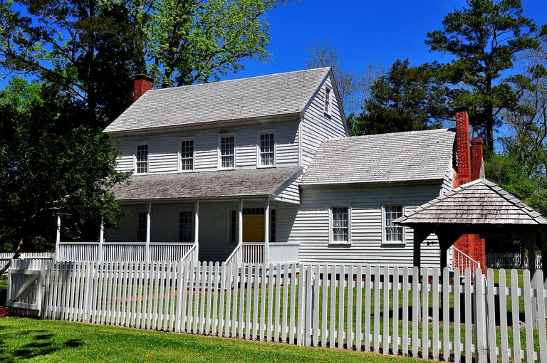 Bath, North Carolina:  Circa 1820 wooden frame Bonner House with portico, ell addition, and white fence *
