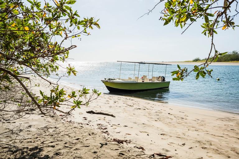 Tourboat anchored at Tamarindo beach,  Guanacaste, Costa Rica