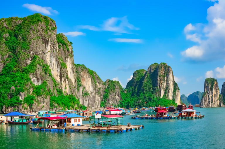 Floating fishing village and rock islands in Halong Bay, Vietnam, Southeast Asia. UNESCO World Heritage Site.