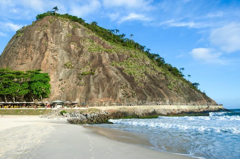 Scenic karst mountain landscape of the Morro do Leme at the end of Copacabana Beach in Rio de Janeiro, Brazil