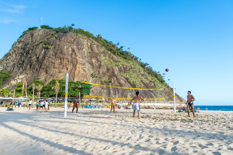 RIO DE JANEIRO - FEBRUARY 10, 2015: Young Brazilian men play a game of footvolley, a sport that combines football and volleyball