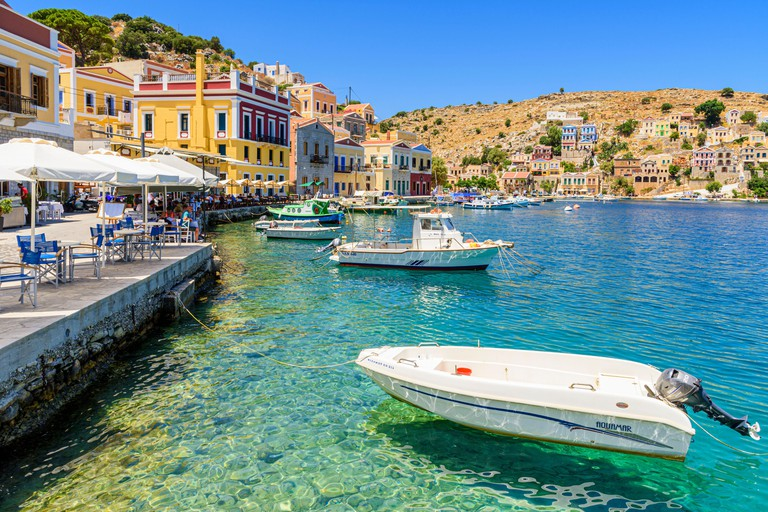2E0GNTJ The colourful waterfront of Yialos Town on the island of Symi, Dodecanese, Greece