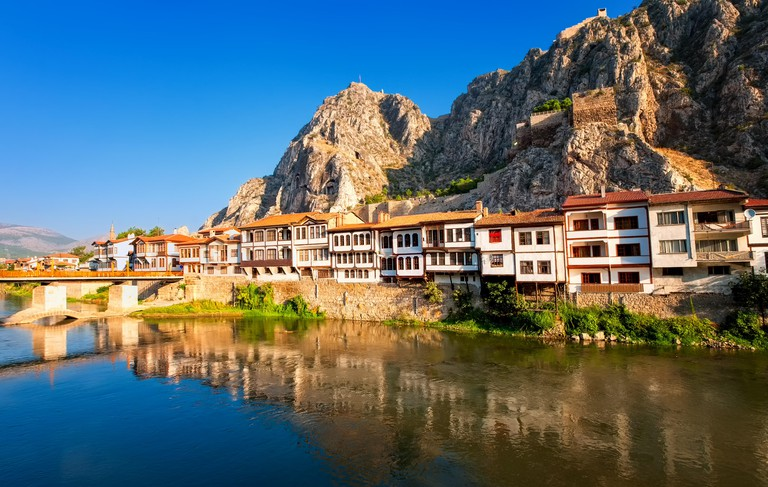 Traditional ottoman houses reflecting in the river, Amasya, Turkey
