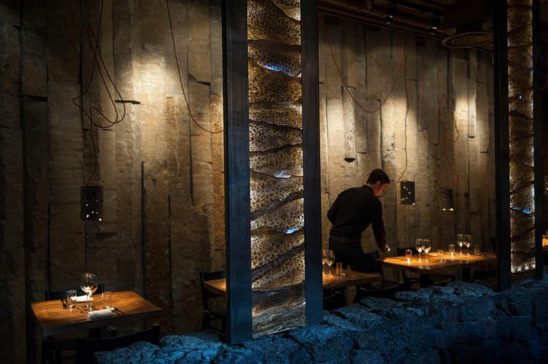 Grillmarkadurinn restaurant in Reykjavik, stylishly decorated with lava rocks and fish skin lampshades. E9WMXN
