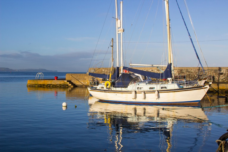 Yachts  in the calm waters of Groomsport Harbour in Northern Ireland and pictured in the soft glow of mid winter sunlight