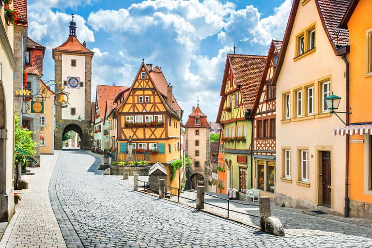 Classic postcard view of the historic town of Rothenburg ob der Tauber on a sunny day with blue sky, Franconia, Bavaria, Germany