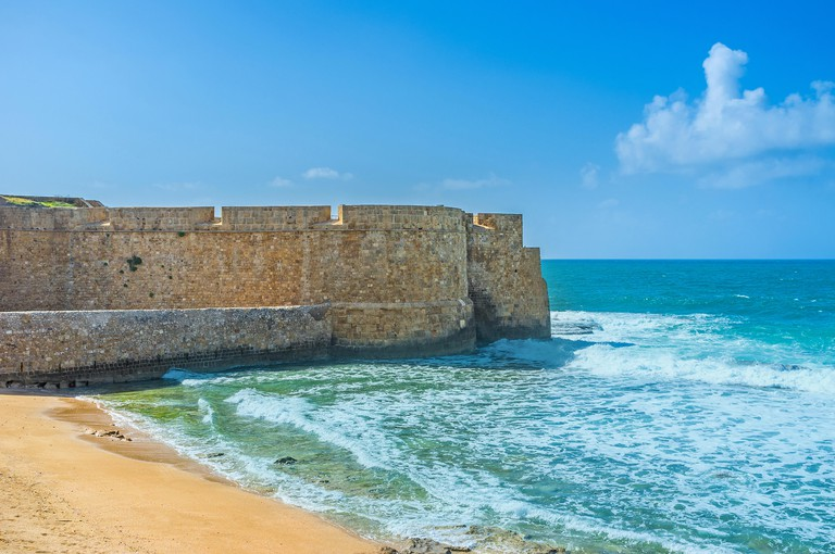The city beach located adjacent to the sea walls of Akko, Israel.