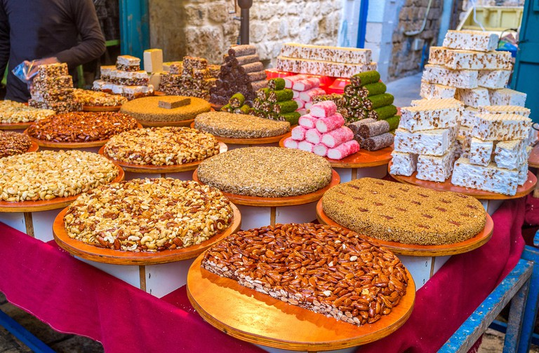 The gozinaki, made of nuts, sesame and sunflower seeds, colorful lokum and sweet halva in the stall of the Turkish Bazaar, Acre